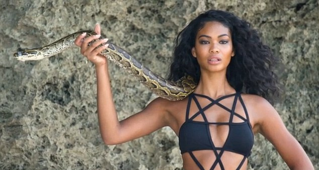 Chanel Iman poses with Python for Sports Illustrated