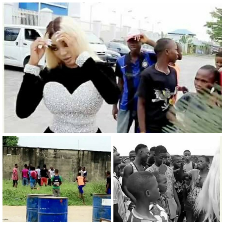 Camer artist Dencia stops a group of Children from fighting in Nigeria.